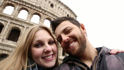 Happy young romantic couple traveling in Italy
