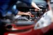 Mechanic working in auto repair garage - 76281074
