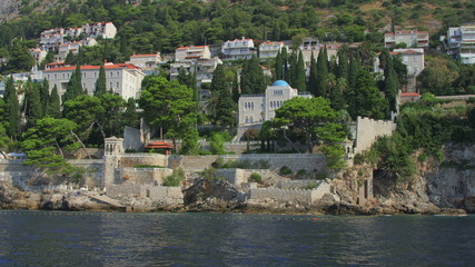 Dubrovnik old town surroundings with rocky beach.