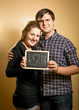 "couple in love holding blackboard with ""I love you"" written by c"