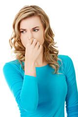 Portrait of a woman clogging nose