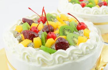 fruits cake fresh cream on white background