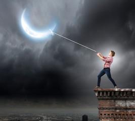 Man pulling moon