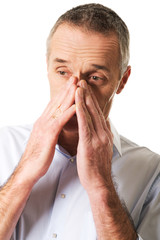 Man suffering from sinus pressure pain