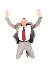 Excited businessman jumping because of success