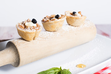 Apple Tarts served on a wooden rolling pin