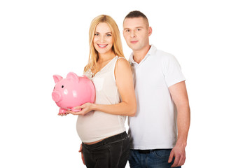 Beautiful young couple with piggy bank