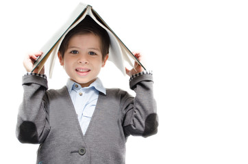 Little boy holding book on white background