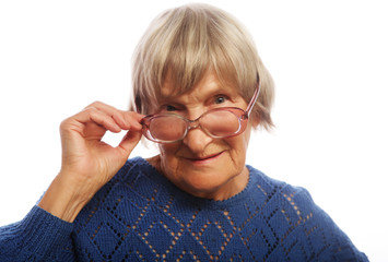 old senior lady looking through her eyeglasses