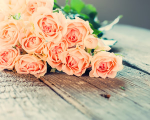 Bouquet of Tender Roses on Wooden Table