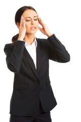 Businesswoman having huge headache