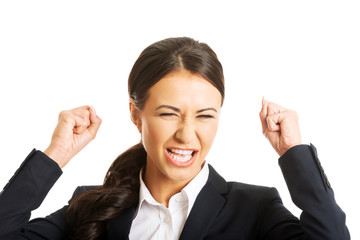 Portrait of angry businesswoman making fists
