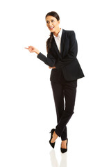 Business woman showing copy space on the left