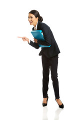 Businesswoman with binder pointing to the left