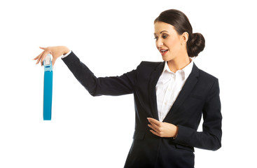 Businesswoman pretending to drop a binder