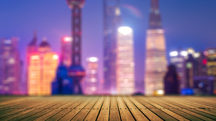 Blurred city lights and office buildings