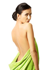Back view woman wrapped in towel