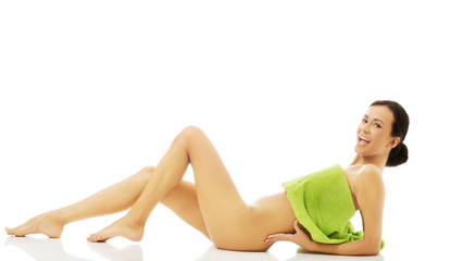 Side view woman lying wrapped in towel
