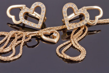 gold jewelry in the shape of hearts