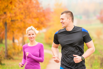 healthy lifestyle - jogging. a man and a woman running in the mo