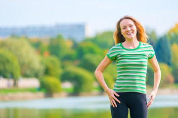 portrait of cheerful red-haired girl in a green T-shirt