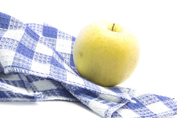Fresh yellow apple healthy fruit on blue tablemat