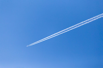 trace of an airplane in the blue sky