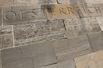 Osterreich (Austria). Word carved into the stone blocks.