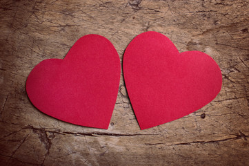 Red hearts on wooden table