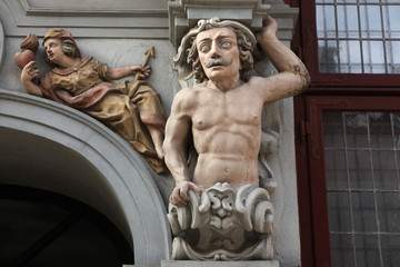 Muscular mustached atlas supported a Renaissance house in Gdansk
