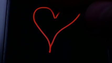 heart on the black screen of a smartphone