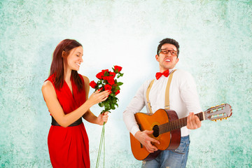 Romantic Man Singing with Guitar to Girlfriend