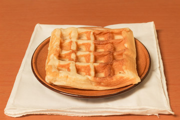 fresh waffle on the brown dish