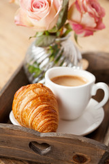 Romantic breakfast with coffee and croissant