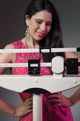 Beautiful woman on the scale