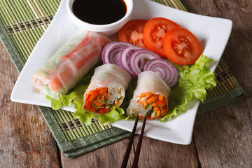 vegetable spring rolls with sauce horizontal top view