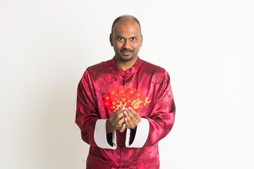 indian male with chinese new year clothes and ang pao