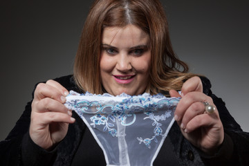 Woman holding a thong