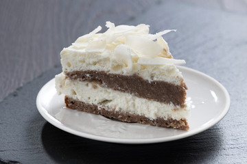 piece of chocolate cake with coconut cream