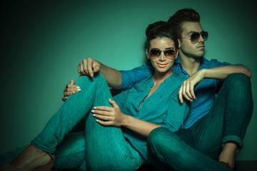 Fashion couple posing on studio background