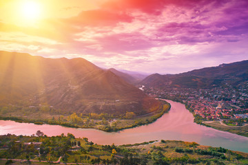 Evening panoramic view of Mtskheta city and Kura river