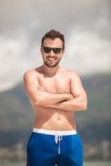 happy man posing on the beach of seychelles
