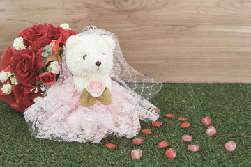 Bear toy with candy and rose
