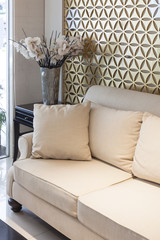 Living room Sofa with pillows and flower, Interior decoration
