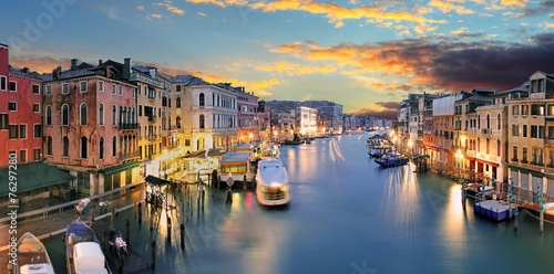 Ponte Rialto and gondola at sunset in Venice, Italy © TTstudio