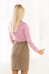 Rear View Of Pretty Blonde With Thumb-Up