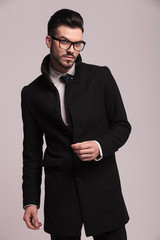 Attractive young business man wearing a elegant long coat