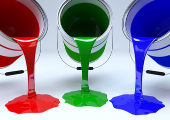 Pouring red, green and blue paint