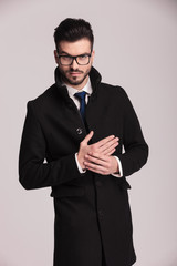 young business wearing a long elegant coat