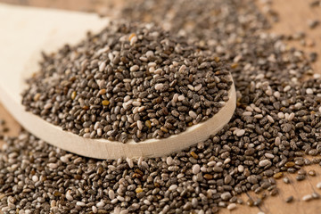 chia seeds on wooden surface